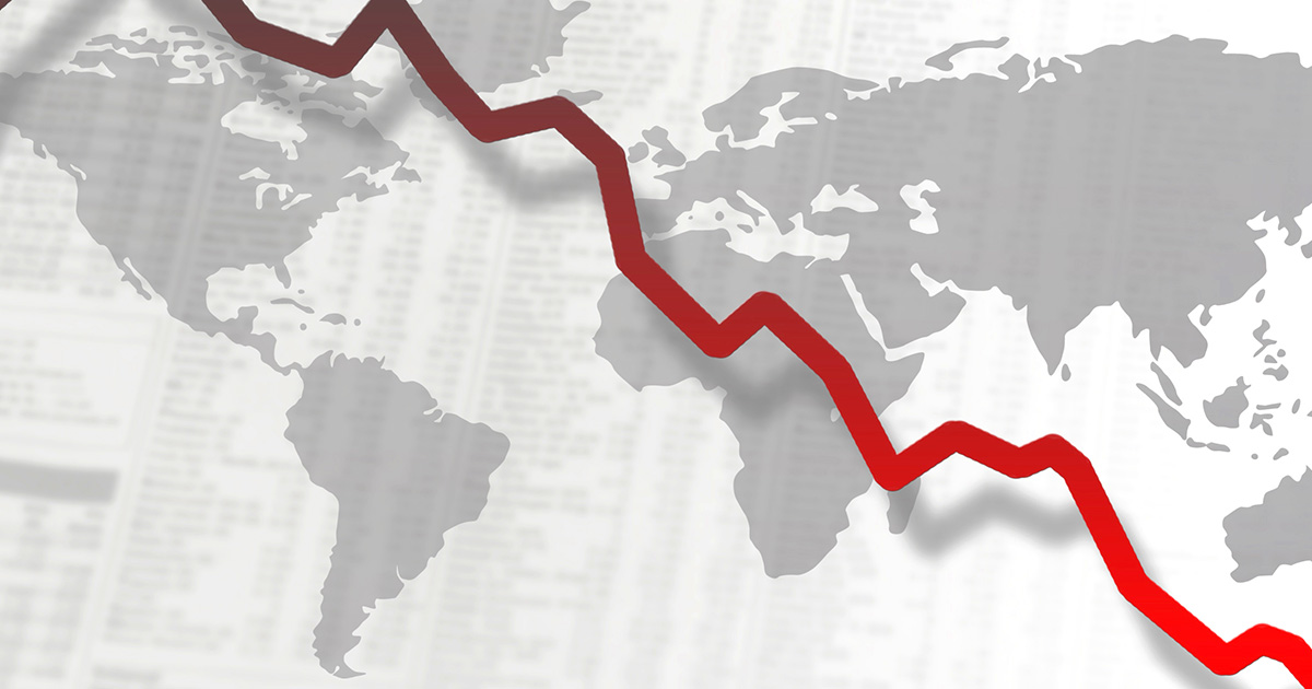 A descending red line graph is seen plummeting, in an undulating movement, across the frame, with a map of the world composed of grey territorial outlines visible in the background, positioned at a slightly diagonal angle