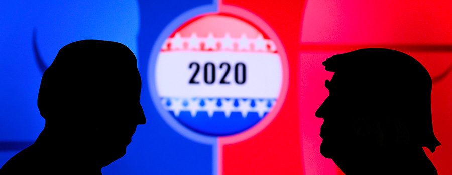 The two-dimensional silhouettes of Donald Trump and Joe Biden are seen facing each other, in profile view, with a background centrepieced by a large presidential campaign badge displaying the figure 2020, adorned with white stars and exhibiting red, blue and white striping, all of which appears against a backdrop split down the middle by panes in two solid blocks of blue and red.
